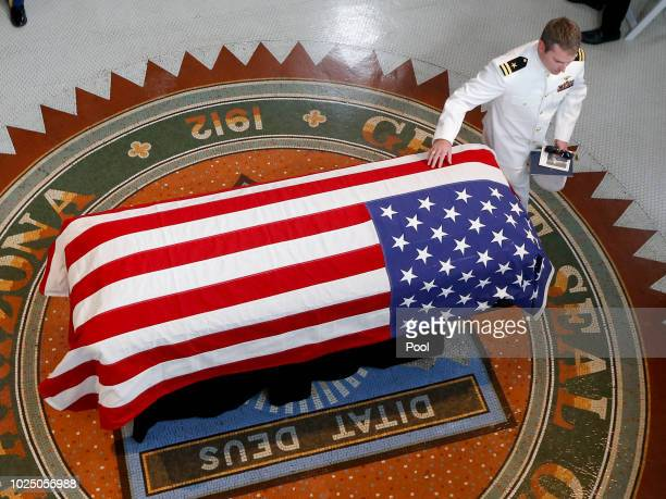 Jack McCain, son of, Sen. John McCain, R-Ariz. Touches the casket during a memorial service at the Arizona Capitol on August 29, 2018 in Phoenix,...