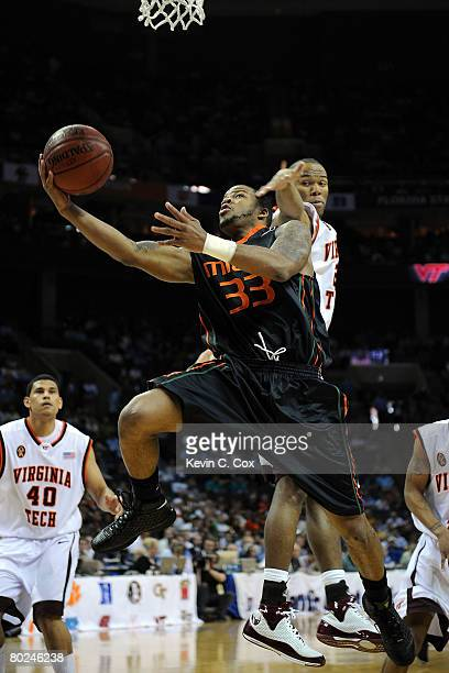 Jack McClinton of the Miami Hurricanes goes up for a shot against Lewis Witcher of the Virginia Tech Hokies during day two of the 2008 Men's ACC...