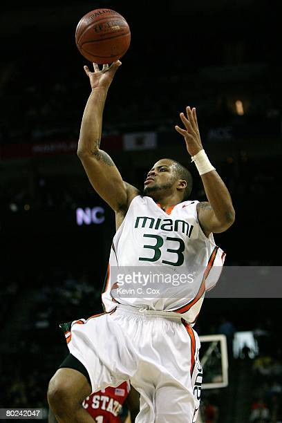 Jack McClinton of the Miami Hurricanes shoots in the lane against the North Carolina Wolfpack during Day 1 of the 2008 Men's ACC Basketball...