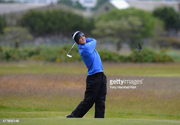 Jack McDonald of Kilmarnock plays his second shot on the 12th fairway during The Amateur Championship 2015 Day Four at Carnoustie Golf Club on June...