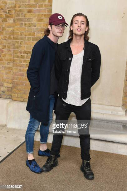 Jack McEvoy and Elijah Rowen attend Beyond the Road Exhibition Opening Private Viewing at the Saatchi Gallery on June 11 2019 in London England