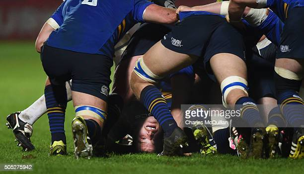 Jack McGrath of Leinster peers out from underneath a pile of bodies during the European Champions cup Pool 5 rugby game at the RDS arena on January...
