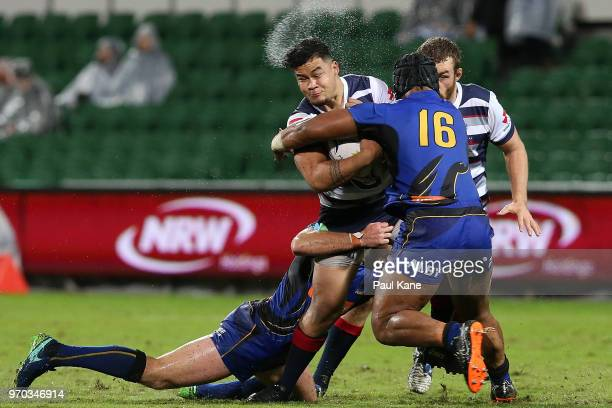 Jack McGregor of the Rebels gets tackled by Alifeleti Kaitu'u of the Force during the World Series Rugby match between the Force and the Rebels at...