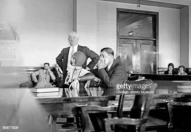Jack McGurn suspected killer in the St Valentine's Day Massacre and his sweetheart Louise Rolfe sitting at a table in a courtroom in Chicago Illinois...