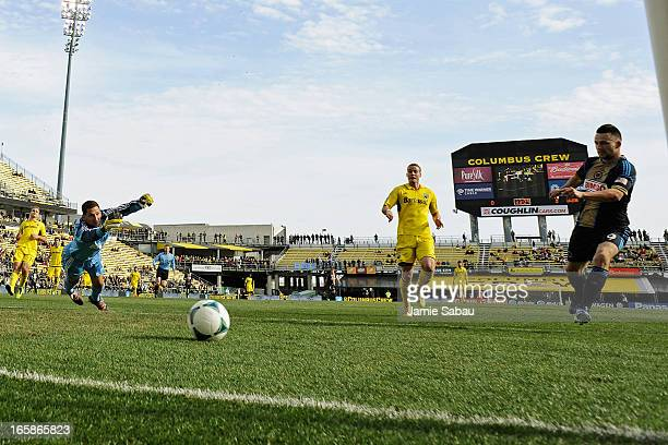 Jack McInerney of Philadelphia Union kicks in the ball for a goal past goalkeeper Andy Gruenebaum of the Columbus Crew in the first half on April 6...