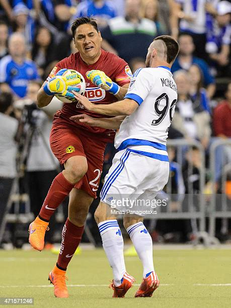Jack McInerney of the Montreal Impact runs into goalkeeper Moises Munoz of Club America after Munoz made a save in the 2nd Leg of the CONCACAF...