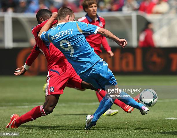 Jack McInerney of the Philadelphia Union scores the game winning goal past Jalil Anibaba of the Chicago Fire during an MLS match at Toyota Park on...