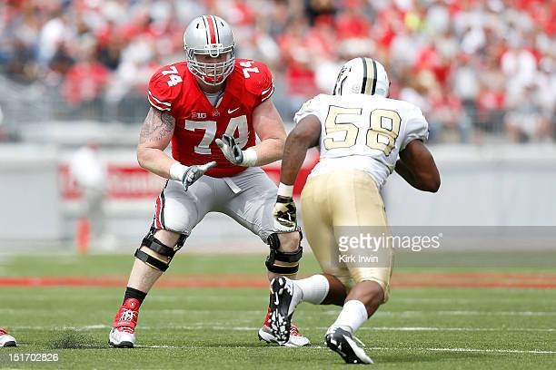 Jack Mewhort of the Ohio State Buckeyes lines up against Troy Davis of the Central Florida Knights on September 8, 2012 at Ohio Stadium in Columbus,...