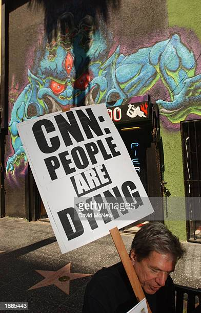 Jack Michon holds a sign criticizing Cable News Network's coverage of the USled war against Iraq during a demonstration March 22 2003 in Hollywood...