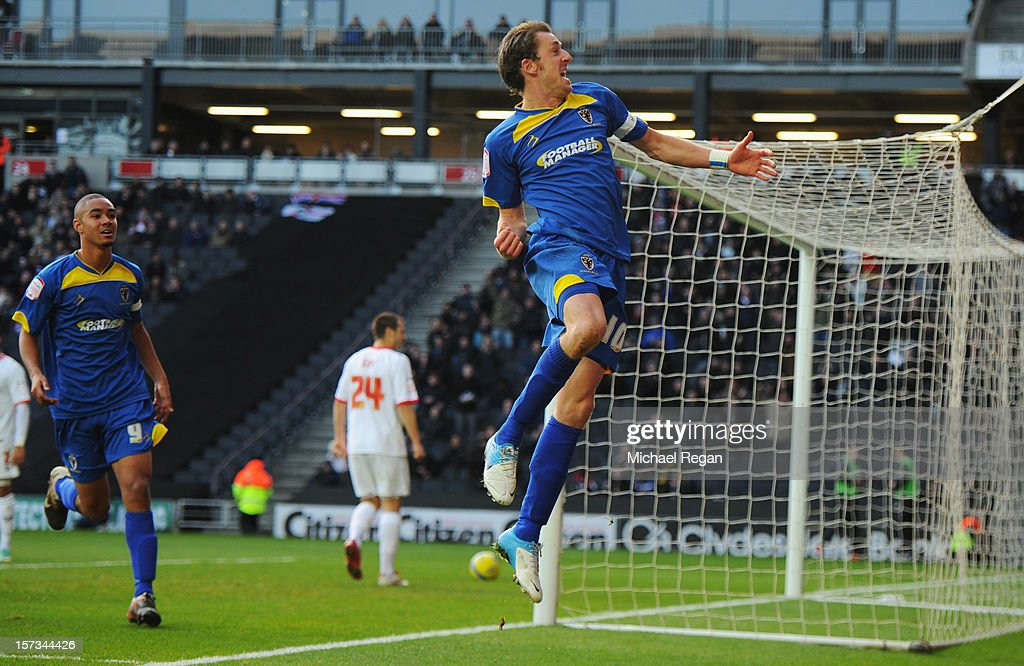 Jack Midson of AFC Wimbledon celebrates as he scores their first goal during the FA Cup with Budweiser Second Round match between MK Dons and AFC Wimbledon at StadiumMK on December 2, 2012 in Milton Keynes, England. This match is the first meeting between the two teams following the formation of AFC Wimbledon (the football club formed in 2002 by supporters unhappy with their club's relocation to Milton Keynes) and the MK Dons (which Wimbledon F.C. controversially became).