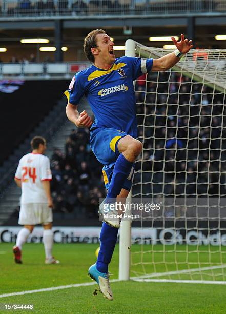 Jack Midson of AFC Wimbledon celebrates as he scores their first goal during the FA Cup with Budweiser Second Round match between MK Dons and AFC...