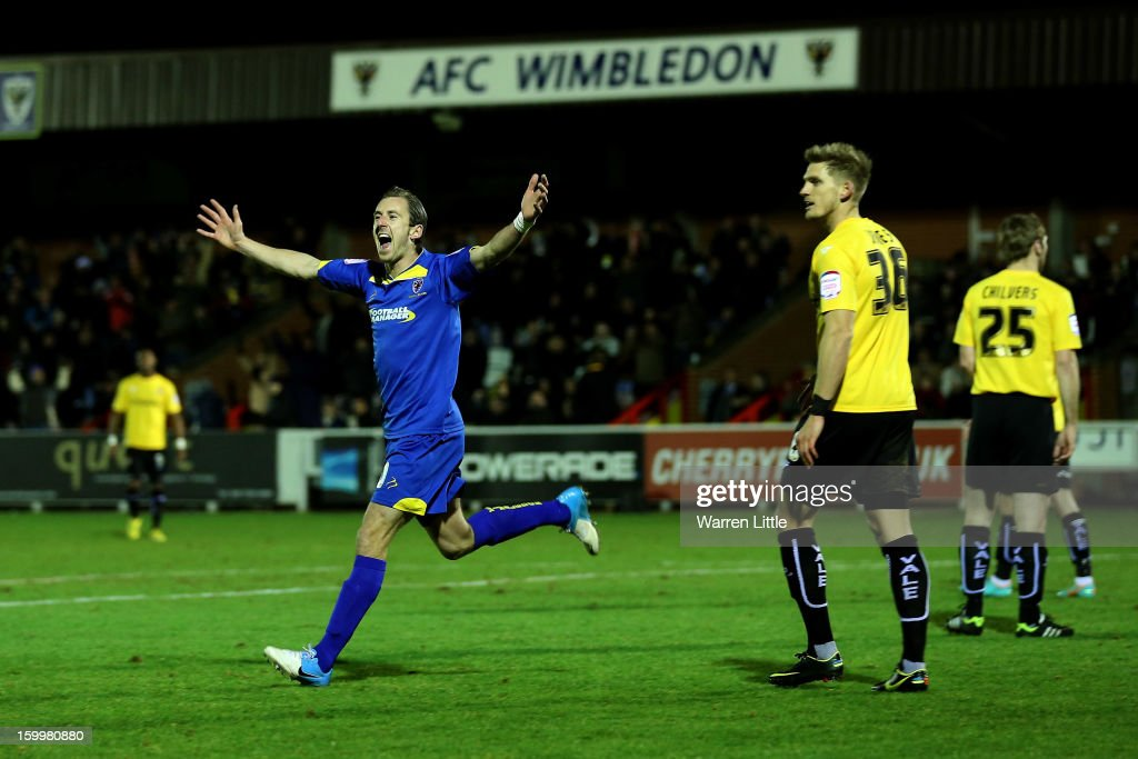 Jack Midson of AFC Wimbledon celebrates scoring the opening goal during the npower League Two match between AFC Wimbledon and Port Vale at The Cherry Red Records Stadium on January 24, 2013 in Kingston upon Thames, England.