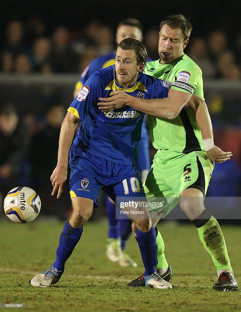 Jack Midson of AFC Wimbledon looks to control the ball under pressure from Kelvin Langmead of Northampton Town in action during the npower League Two match between AFC Wimbledon and Northampton Town at The Cherry Red Records Stadium on February 19, 2013 in Kingston upon Thames, England.
