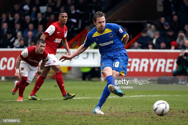 Jack Midson of AFC Wimbledon scores the winning goal during the npower League Two match between AFC Wimbledon and Fleetwood Town at the Cherry Red...