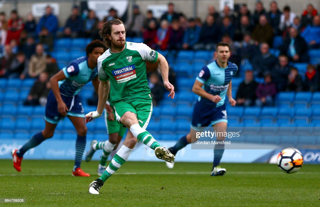 Jack Midson of Letherhead scores his sides first goal from the penalty spot during The Emirates FA Cup Second Round between Wycombe Wanderers and Leatherhead at Adams Park on December 3, 2017 in High Wycombe, England.
