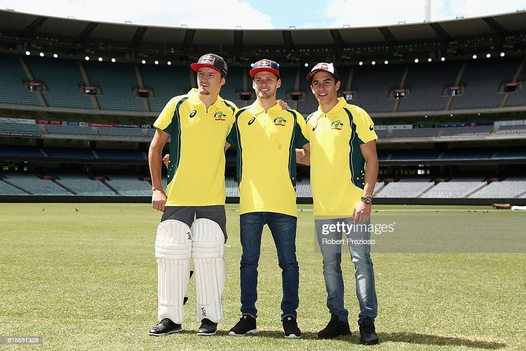 Jack Miller, Brad Binder and Marc Márquez pose for photos during the MotoGP of Australia press conference at Melbourne Cricket Ground on October 19, 2016 in Melbourne, Australia.