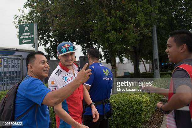 Jack Miller of Australia and Alma Pramac Racing arrives in circuit and poses with fans during the qualifying practice during the MotoGP Of Malaysia...