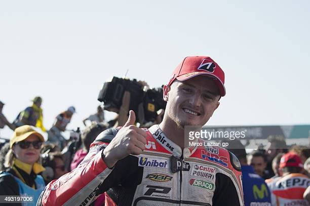 Jack Miller of Australia and CWM LCR Honda celebrates the open victory under the podium at the end of the MotoGP race during the MotoGP of Australia...