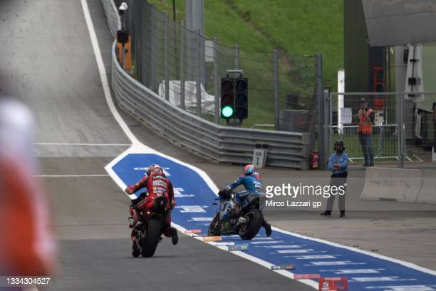 Jack Miller of Australia and Ducati Lenovo Team and Alex Rins of Spain and Team Suzuki ECSTAR restart from box after change the bikes during the...