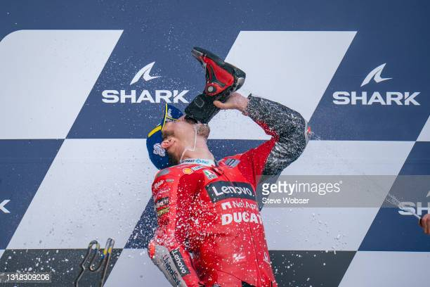 Jack Miller of Australia and Ducati Lenovo Team drinks Prosecco out of his boots after his race win at Bugatti Circuit on May 16, 2021 in Le Mans,...