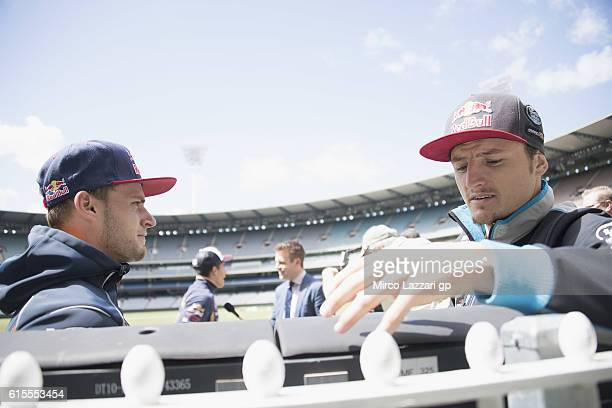 Jack Miller of Australia and Marc VDS Racing Team speaks with Brad Binder of South Africa and Red Bull KTM Ajo during the preevent in Melbourne...