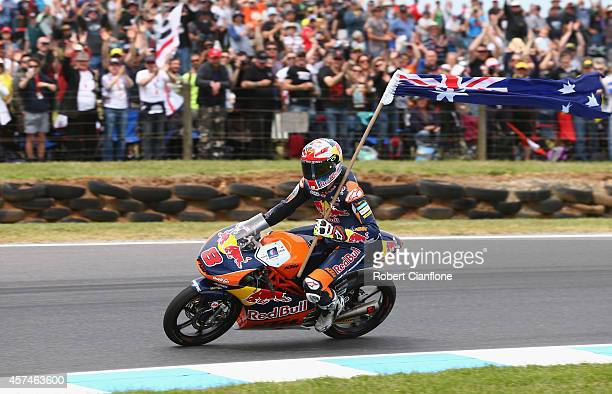 Jack Miller of Australia and rider of the Red Bull KTM AJO ATM celebrates after winning the Moto3 race at the 2014 MotoGP of Australia at Phillip...