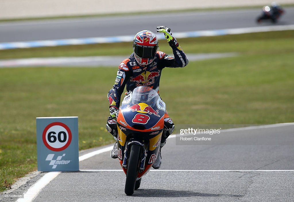Jack Miller of Australia and rider of the #8 Red Bull KTM AJO ATM, gestures as he enters the pits during the qualifying session for the Moto3, at the 2014 MotoGP of Australia at Phillip Island Grand Prix Circuit on October 18, 2014 in Phillip Island, Australia.