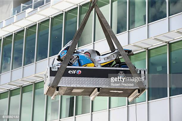 Jack Miller's bike is lowered from the roof after the MotoGP of Australia press conference at Melbourne Cricket Ground on October 19 2016 in...