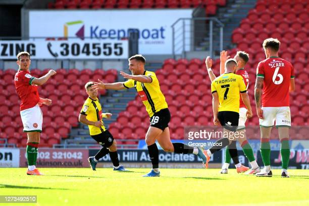 Jack Muldoon of Harrogate Town celebrates after scoring his sides second goal during the Sky Bet League Two match between Harrogate Town and Walsall...