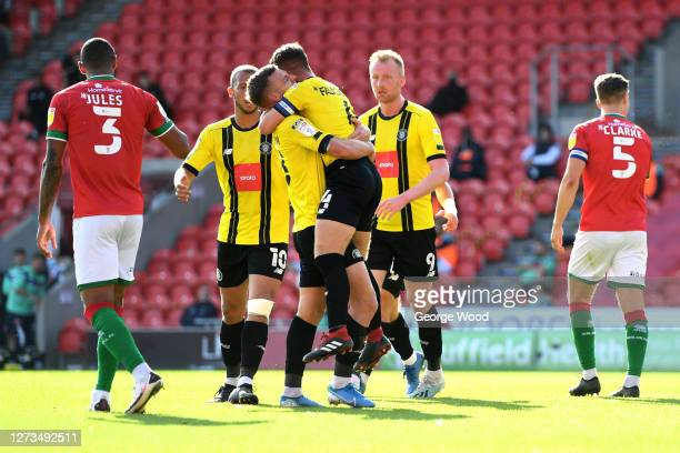 Jack Muldoon of Harrogate Town celebrates with his team mates after scoring his sides second goal during the Sky Bet League Two match between...