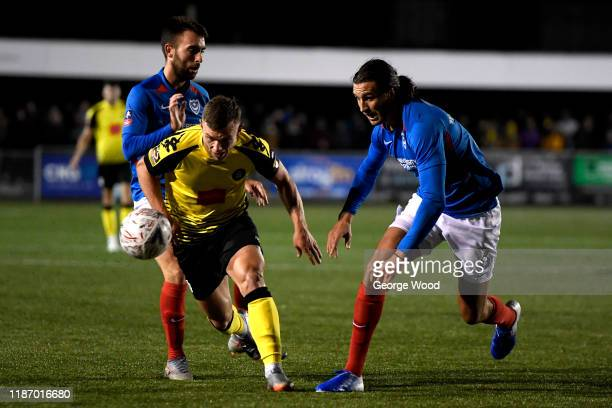 Jack Muldoon of Harrogate Town takes on Christian Burgess of Portsmouth during the FA Cup First Round match between Harrogate Town A.F.C and...