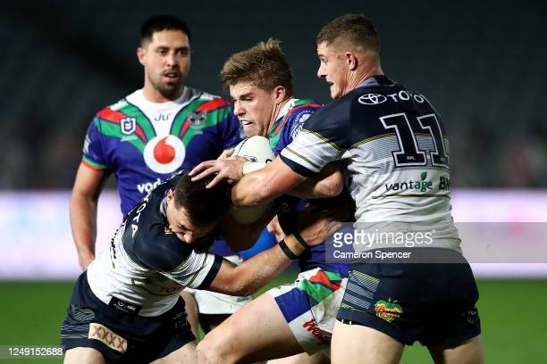 Jack Murchie of the Warriors is tackled during the round five NRL match between the New Zealand Warriors and the North Queensland Cowboys at Central...