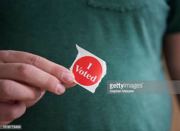 Jack Nachtigal holds up his I Voted sticker after filling out his ballot in the 2018 Minnesota primary election at the Weisman Art Museum polling...