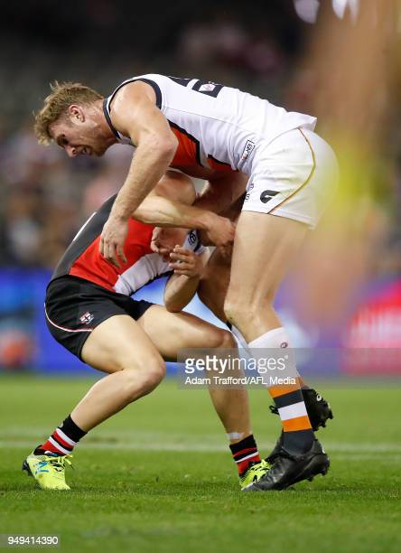 Jack Newnes of the Saints clashes with Dawson Simpson of the Giants during the 2018 AFL round five match between the St Kilda Saints and the GWS...