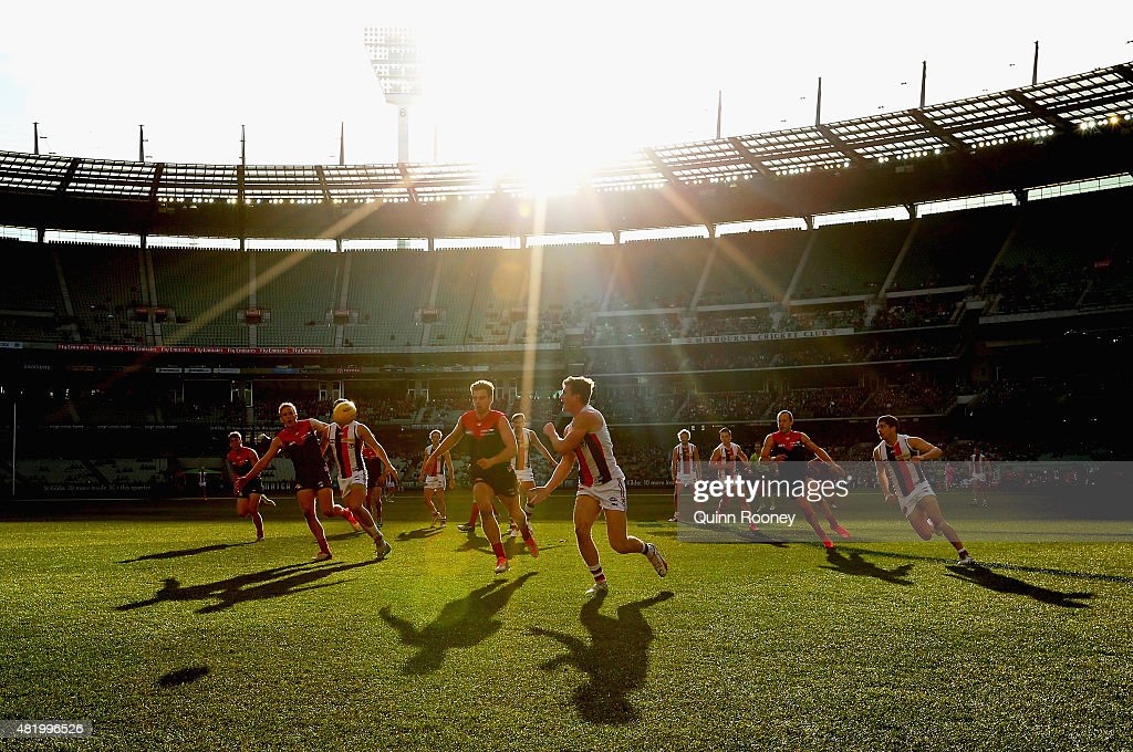 Jack Newnes of the Saints handballs during the round 17 AFL match between the Melbourne Demons and the St Kilda Saints at Melbourne Cricket Ground on July 26, 2015 in Melbourne, Australia.