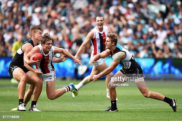 Jack Newnes of the Saints is tackled by Ollie Wines of the Power during the round one AFL match between the Port Adelaide Power and the St Kilda...