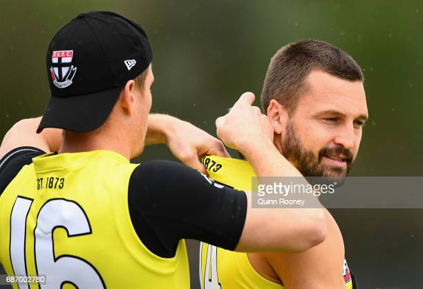 Jack Newnes of the Saints puts the GPS unit in for Jarryn Geary during a St Kilda Saints AFL training session at Linen House Oval on May 23 2017 in...
