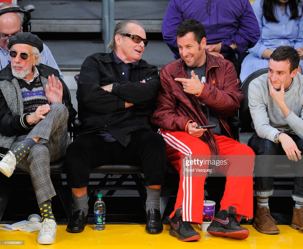 Jack Nicholson (L) and Adam Sandler attend a basketball game between the Houston Rockets and the Los Angeles Lakers at Staples Center on February 19, 2014 in Los Angeles, California.