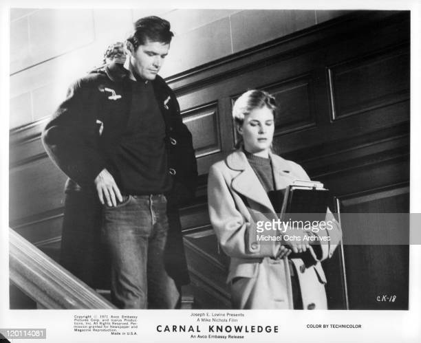 Jack Nicholson and Candice Bergen walking down the stairs in a scene from the film 'Carnal Knowledge', 1971.