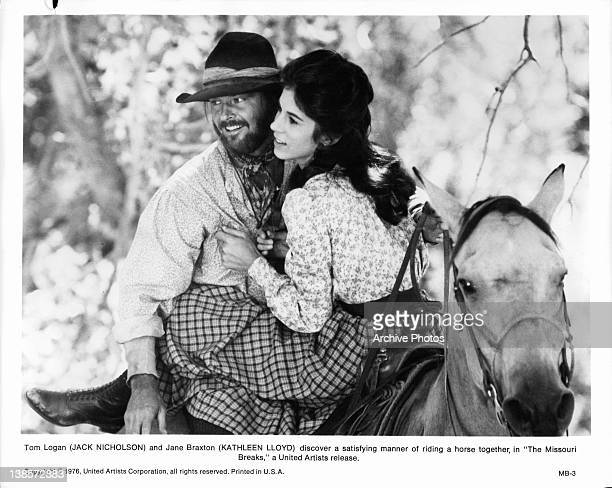 Jack Nicholson and Kathleen Lloyd riding on a horse's back together in a scene from the film 'The Missouri Breaks' 1976