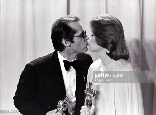 Jack Nicholson and Louise Fletcher kiss at the Academy Awards circa 1976 in Los Angeles