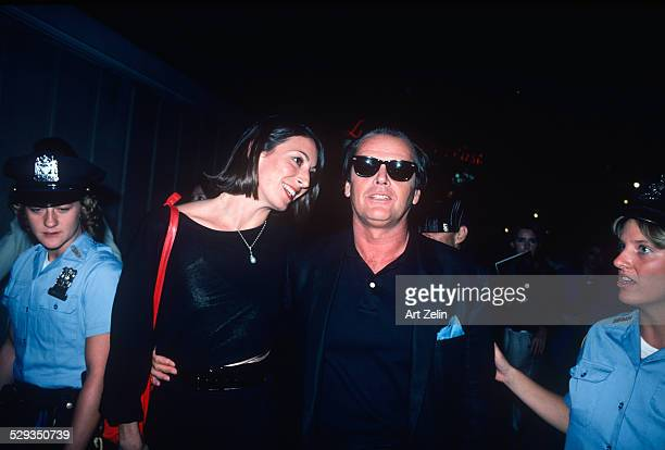 Jack Nicholson holding Anjelica Huston surrounded by female police circa 1970 New York