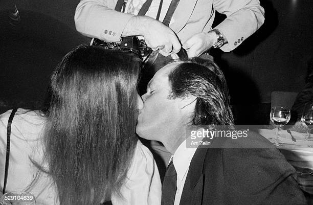 Jack Nicholson kissing Anjelica Huston at a formal dinner circa 1970 New York