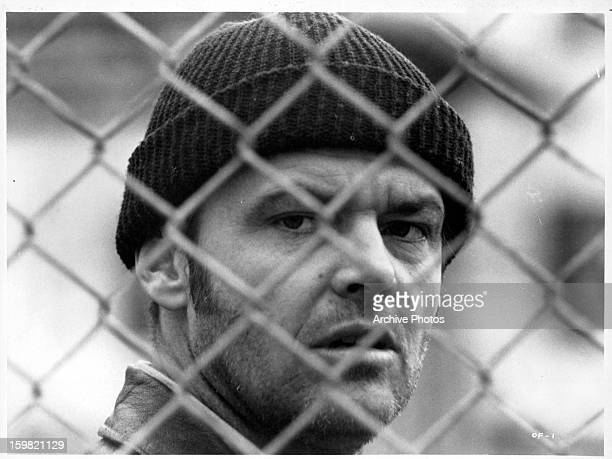 Jack Nicholson looking through fence in a scene from the film 'One Flew Over The Cuckoo's Nest' 1975