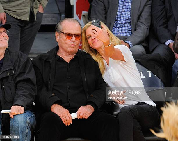 Jack Nicholson poses with a fan at a basketball game between the Indiana Pacers and the Los Angeles Lakers at Staples Center on January 28 2014 in...