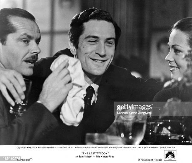 Jack Nicholson Robert De Niro and Ingrid Boulting celebrating at table in a scene from the film 'The Last Tycoon' 1976