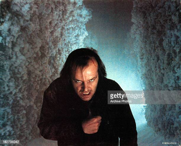 Jack Nicholson walking through snowy maze in lobby card for the film 'The Shining' 1980