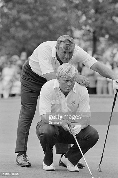 Jack Nicklaus and Arnold Palmer line up a putt during the Ryder Cup playoffs here. Nicklaus and Palmer were teamed together against Peter Townsend...