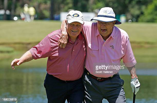 Jack Nicklaus and Arnold Palmer walk to the third green during the Greats of Golf exhibition at the Insperity Championship at the Woodlands Country...
