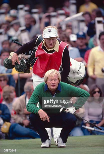 Jack Nicklaus and his son and caddie Jackie Nicklaus line up a put during the 1982 US Open on June 20 1982 in Pebble Beach California Nicklaus...